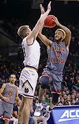 SOUTH BEND, IN - JANUARY 12: Ky Bowman #0 of the Boston College Eagles shoots the ball against Dane Goodwin #23 of the Notre Dame Fighting Irish at Purcell Pavilion on January 12, 2019 in South Bend, Indiana. (Photo by Michael Hickey/Getty Images) *** Local Caption *** Ky Bowman; Dane Goodwin