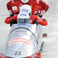 28 February 2007:     The Canada 2 bobsled driven by Lyndon Rush with sidepushers Robert Sean Thomas Gray and Chris Le Bihan, and brakeman Lascelles Brown jump into the sled at the start of the 2nd run at the 4-Man World Championships competition on February 27 at the Olympic Sports Complex in Lake Placid, NY.