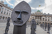 Masque of Blackness by Zak Ové, in the Edmond J. Safra Fountain Court Somerset House to launch 1:54 Contemporary African Art Fair. Inspired by, and in reaction to, the heritage of Somerset House and an early Jacobean era court masque, Ové's resin and jesmonite sculptures will place a Nubian army of masked men within the fountains, reclaiming the grand surroundings of historical British establishment for 'diasporic beauty'.