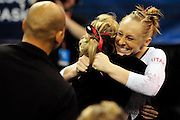 University of Utah senior Jacquelyn Johnson gets a hug from a teammate after her balance beam routine at the 2011 Women's NCAA Gymnastics Championship Team Finals on April 16, in Cleveland, OH. (photo/Jason Miller)