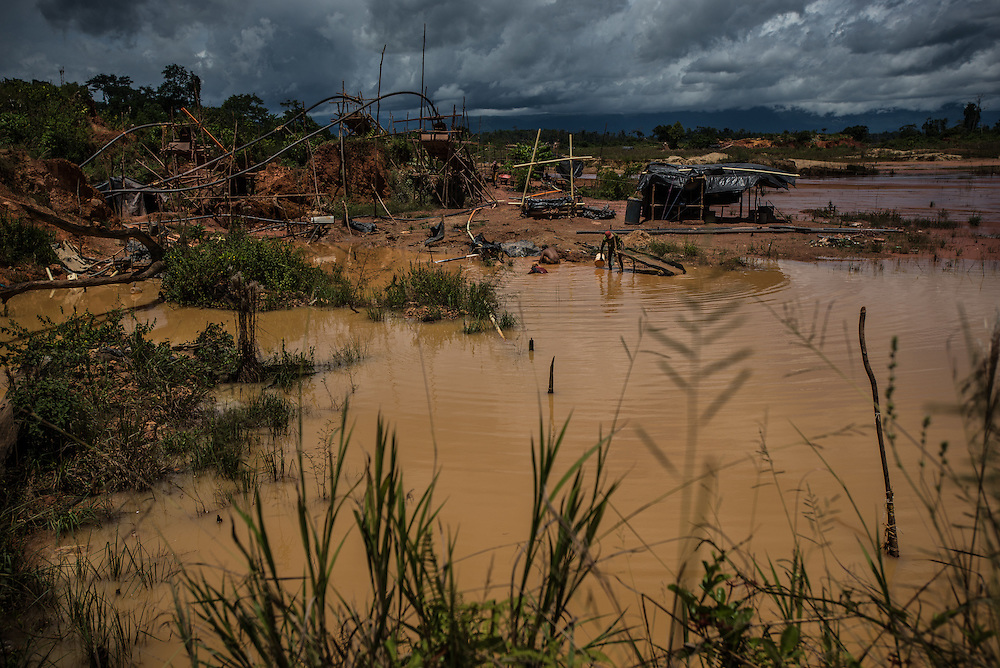 LAS CLARITAS, VENEZUELA - JULY 20, 2016:  Thousands of Venezuelans are flocking to illegal gold mines, like this one, in hopes of surviving the current economic crisis by earning in gold instead of the national currency, whose value steadily falls due to the world's highest inflation.  From this remote part of the jungle the migrant miners have become the vectors of a new epidemic of malaria, because the hot, swampy conditions of the mines make for an ideal breeding ground for mosquitos. Miners spread the disease as they return home with earnings or pay visits to family members. Dozens of miners that work in this mine said that they have contracted malaria multiple times, some even dozens of times. The economic crisis has also left the government without the financial resources to control the disease - they are unable to fumigate homes, provide medicines to everyone that is sick, or even to test all patients with symptoms of malaria in many places. PHOTO: Meridith Kohut for The New York Times