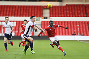 Bolton's U23 Liam Edwards battles with Nottingham Forest U23's Virgil Gomis during the U23 Professional Development League Play-Off Final match between Nottingham Forest and Bolton Wanderers at the City Ground, Nottingham, England on 4 May 2018. Picture by Jon Hobley.