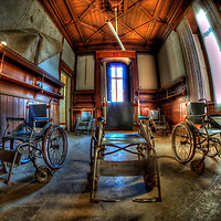 Wheelchairs in an old empty room