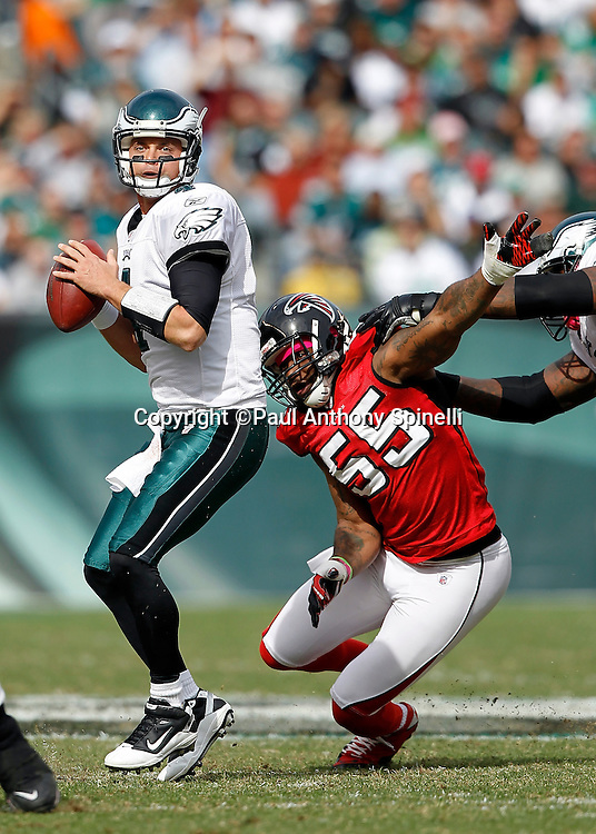 Philadelphia Eagles quarterback Kevin Kolb (4) gets pressured from behind by Atlanta Falcons defensive end John Abraham (55) during the first quarter of the NFL week 6 football game against the Atlanta Falcons on Sunday, October 17, 2010 in Philadelphia, Pennsylvania. The Eagles won the game 31-17. (©Paul Anthony Spinelli)