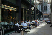 City workers eat lunch outside during an unusual autumn heatwave on 13th September 2016, in the City of London, England.