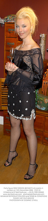 Party figure MISS TAMARA BECKWITH at a party in London on 12th December 2002.<br />PGD 33