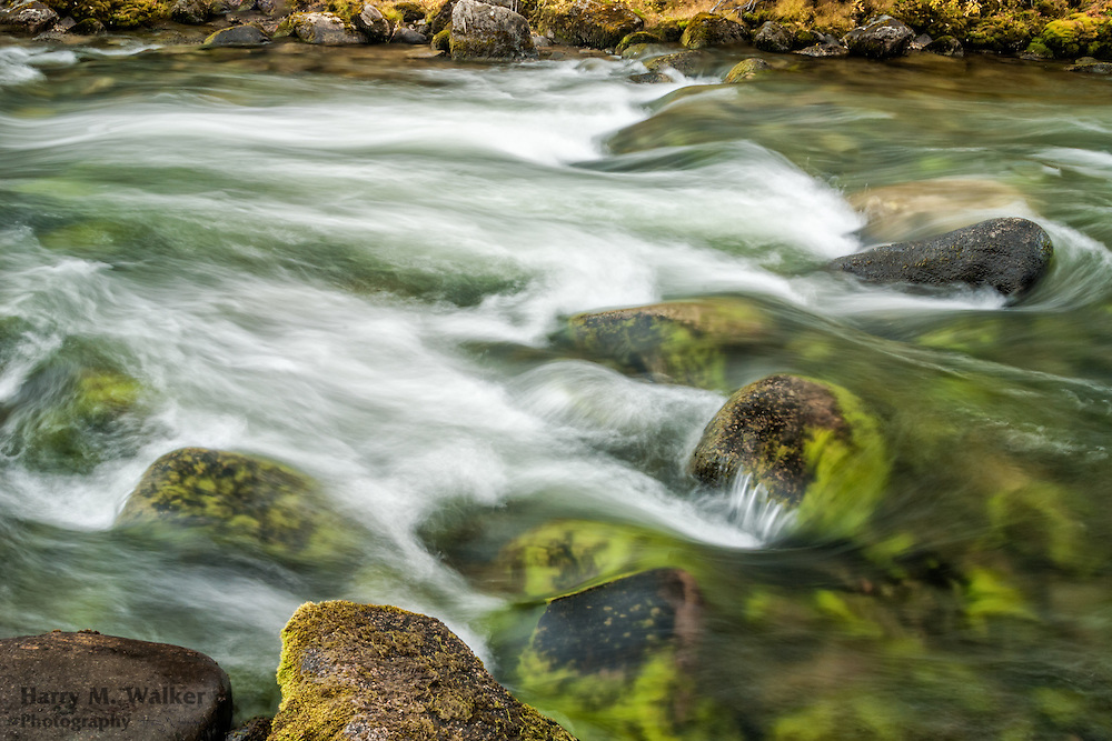 Brushkana Creek flows over numerous rocks next to Denali Highway; Interior Alaska