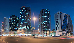 Skyline of new office towers at night  in Business Bay district of Dubai United Arab Emirates