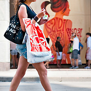 MILAN, ITALY - JULY 03:  A girl walks past a sale sign in the fashion shopping area of Milan on July 3, 2010 in Milan, Italy. Milan's summer sales start today. .***Agreed Fee's Apply To All Image Use***.Marco Secchi /Xianpix. tel +44 (0) 207 1939846. e-mail ms@msecchi.com .www.marcosecchi.com