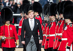 © Licensed to London News Pictures. 23/10/2018. London, UK. King Willem-Alexander of the Netherlands, inspects the guard, during a ceremony on Horse Guards Parade in London for the arrival of King Willem-Alexander and Queen Maxima of the Netherlands as part of a state visit to the UK. Photo credit: Ben Cawthra/LNP