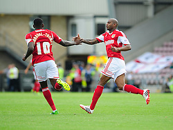 Bristol City's Marvin Elliott congratulates Bristol City's Jay Emmanuel-Thomas on his part of the goal  - Photo mandatory by-line: Dougie Allward/JMP - Tel: Mobile: 07966 386802 11/08/2013 - SPORT - FOOTBALL - Sixfields Stadium - Sixfields Stadium -  Coventry V Bristol City - Sky Bet League One
