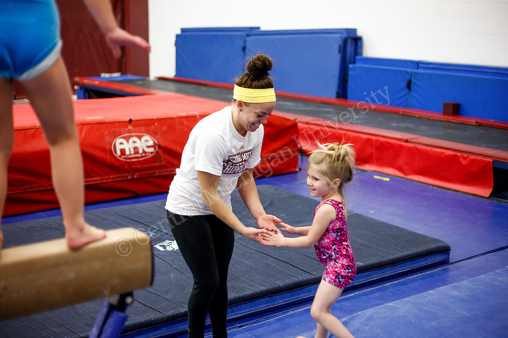 Every Tuesday evening at 6PM, children ages 4 - 8 have the chance to be coached by CMU Gymnasts at Rose Arena. Gymnasts this Tuesday included Emily Heinz, Preslee Harrald and Brittany Pretzold. Photos by Charlotte Bodak