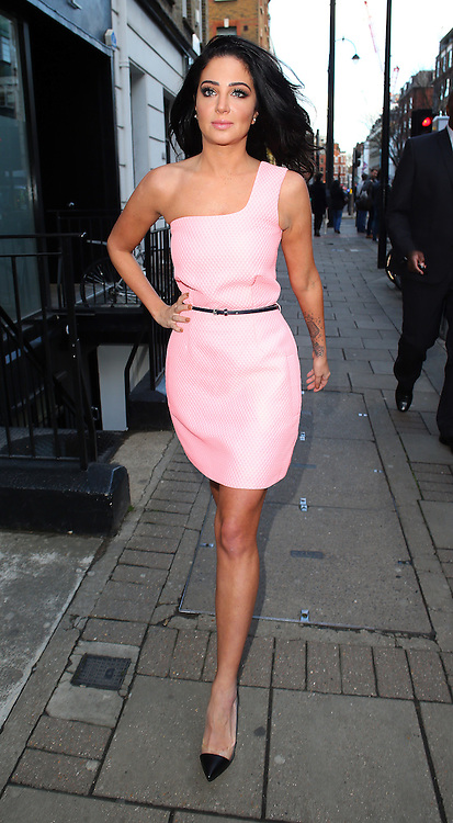 Tulisa Contostavlos looking stunning in a one shoulder pink dress leaving a hair salon in London, UK. <br />