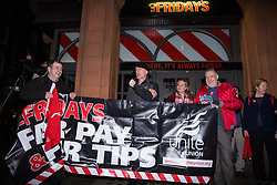 London, UK. 14th February, 2019. Members and supporters of the Restaurant, Catering and Bar Workers Branch of Unite the Union mark the first anniversary of a strike - since ended - for fair tips and fair pay by TGI Fridays workers outside a branch of the chain in Covent Garden. Unite plan to call on HMRC next week to conduct two investigations into the conduct of TGI Fridays, one regarding their Tronc scheme for tips and the other regarding minimum wage issues.