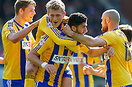 George Saville celebrates with Brentford goalscorer Marcello Trotta during the Sky Bet League 1 match at the Matchroom Stadium, London<br /> Picture by Mark D Fuller/Focus Images Ltd +44 7774 216216<br /> 15/03/2014