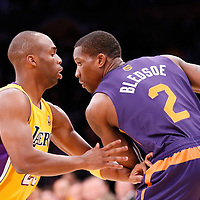 10 December 2013: Los Angeles Lakers shooting guard Jodie Meeks (20) defends on Phoenix Suns point guard Eric Bledsoe (2) during the Phoenix Suns 114-108 victory over the Los Angeles Lakers at the Staples Center, Los Angeles, California, USA.