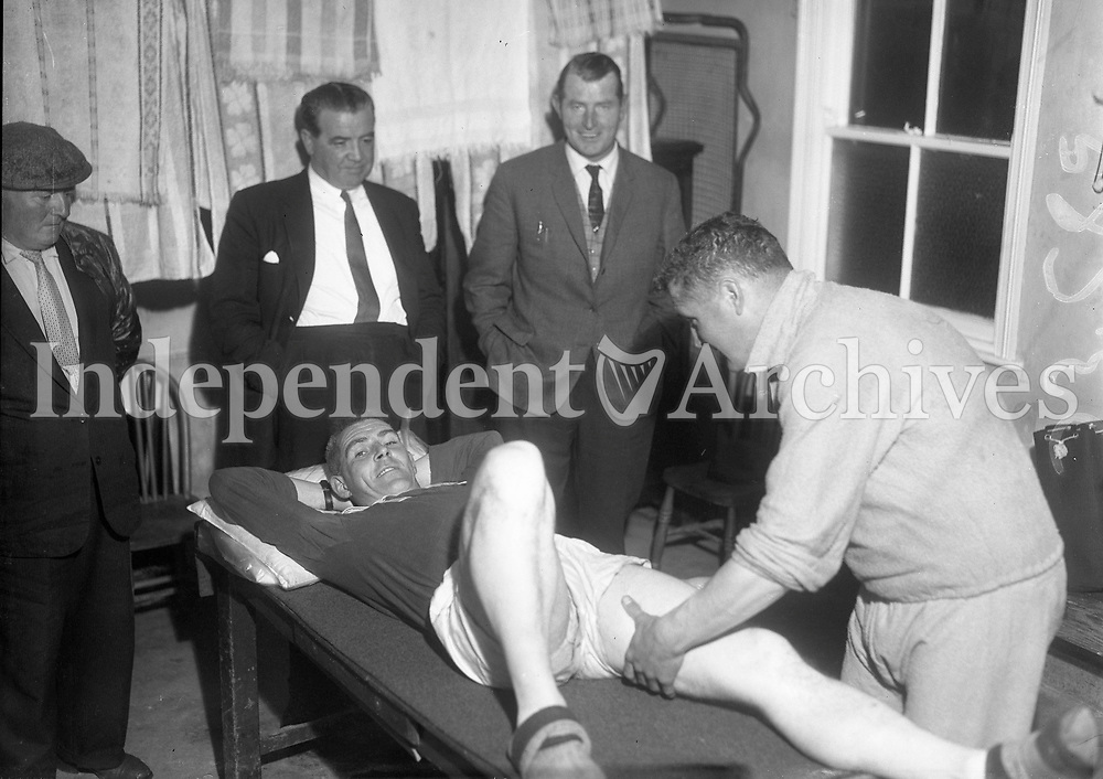 R3352 <br /> Wexford Hurling Team Special. M.Quinn rubs down Podge Kehoe, as Nicky Rackard &amp; Dr.P.J.Daly looks on. 27/08/1962 (Part of the IndepeNewspapers Ireland/NLI Collection)