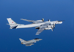 NORTH SEA -- 16 Sep 2014 -- A Russian Bear aircraft is escorted by a Royal Air Force Quick Reaction Alert (QRA) Typhoon during an intercept in September 2014. Royal Air Force aircraft at RAF Lossiemouth launched the Quick Reaction Alert (QRA) for the first time since the Moray base took on the role of defending the UK s Northern airspace. Typhoon jets were scrambled to identify aircraft in international airspace. The aircraft, identified as Russian military Tupolev Tu-95, did not enter UK airspace. EXPA Pictures © 2016, PhotoCredit: EXPA/ Photoshot/ Atlas Photo Archive/RAF/UK MoD<br /><br />*****ATTENTION - for AUT, SLO, CRO, SRB, BIH, MAZ only*****