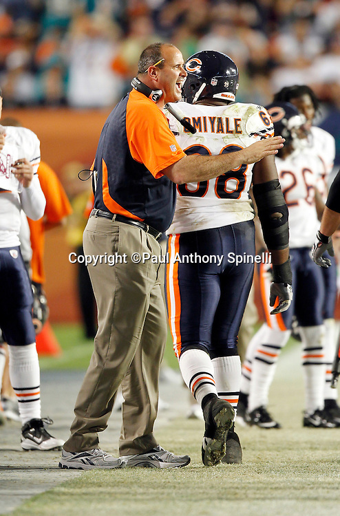 Chicago Bears offensive line coach Mike Tice yells out and congratulates his players after a score during the NFL week 11 football game against the Miami Dolphins on Thursday, November 18, 2010 in Miami Gardens, Florida. The Bears won the game 16-0. (©Paul Anthony Spinelli)