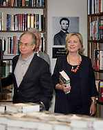 Huntington, New York, U.S. - August 6, 2014 - HILLARY RODHAM CLINTON arrives at book signing to promote her new memoir, Hard Choices, at Book Revue in Huntington, Long Island, during a nationwide tour. Left of her are Book Revue co-owners, brothers RICHARD KLEIN, and behind him ROBERT KLEIN.  Clinton's book is about her four years as America's 67th Secretary of State and how they influence her view of the future.