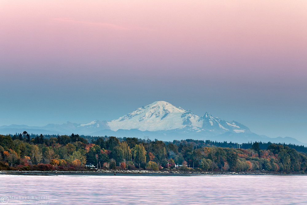 Mount Baker after sunset.  Photographed from the White Rock Pier in White Rock, British Columbia, Canada.  Mount Baker is in Washington State.