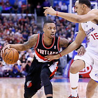 12 February 2014: Los Angeles Clippers center Ryan Hollins (15) defends on Portland Trail Blazers point guard Damian Lillard (0) during the Los Angeles Clippers 122-117 victory over the Portland Trail Blazers at the Staples Center, Los Angeles, California, USA.
