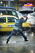 csz030413.001.001.jpg. The Age NEWS  Lonsdale street Melbourne, the heavens open up with rain as a man with a umbrella tries to leap water running down a driveway.. 13th April 2003. S. Picture By Craig Sillitoe melbourne photographers, commercial photographers, industrial photographers, corporate photographer, architectural photographers, This photograph can be used for non commercial uses with attribution. Credit: Craig Sillitoe Photography / http://www.csillitoe.com<br /> <br /> It is protected under the Creative Commons Attribution-NonCommercial-ShareAlike 4.0 International License. To view a copy of this license, visit http://creativecommons.org/licenses/by-nc-sa/4.0/. This photograph can be used for non commercial uses with attribution. Credit: Craig Sillitoe Photography / http://www.csillitoe.com<br /> <br /> It is protected under the Creative Commons Attribution-NonCommercial-ShareAlike 4.0 International License. To view a copy of this license, visit http://creativecommons.org/licenses/by-nc-sa/4.0/.