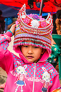 Vietnam, Bac Ha Market, Flower Hmong child in traditional dress