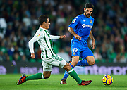 SEVILLE, SPAIN - NOVEMBER 03:  Cristian Tello of Real Betis Balompie (L) competes for the ball with Jorge Molina of Getafe CF (R) during the La Liga match between Real Betis and Getafe at Estadio Benito Villamarin  on November 3, 2017 in Seville, .  (Photo by Aitor Alcalde Colomer/Getty Images)