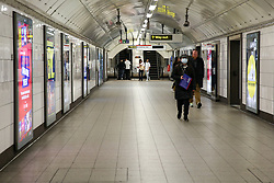 © Licensed to London News Pictures. 16/03/2020. London, UK. A woman wearing a face mask in an empty tunnel at Oxford Circus as commuters and shoppers are avoiding travelling on the London Underground amid an increased number of Coronavirus (COVID-19) cases in the UK. 35 coronavirus victims have died and 1,372 have tested positive forthe virusin the UK as of9amon Sunday, 15 March 2020. Photo credit: Dinendra Haria/LNP