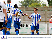 Amari Morgan-Smith is congratulated by Jack Munns during the Pre-Season Friendly match between Weston Super Mare and Cheltenham Town at the Woodspring Stadium, Weston Super Mare, United Kingdom on 18 July 2015. Photo by Carl Hewlett