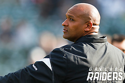 Nov 27, 2011; Oakland, CA, USA; Oakland Raiders head coach Hue Jackson watches his team warm up before the game against the Chicago Bears at O.co Coliseum. Oakland defeated Chicago 25-20. Mandatory Credit: Jason O. Watson-US PRESSWIRE
