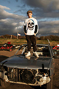 Teenager Standing On Car