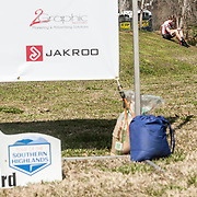WOODSTOCK, VA - MAR 5: L-R: Ben relaxes on a hill and looks at his phone after the road race and final stage of the Tour of the Southern Highlands stage race on Sunday, Mar. 5, 2017 in Woodstock, Ga. Ben finished in 3rd place overall finish against a stacked field of the top talent in the country. (Photo by Jay Westcott/The News & Advance)