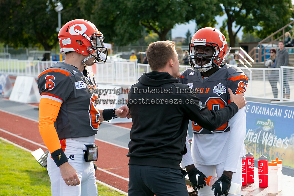 KELOWNA, BC - OCTOBER 6: Javen Kaechele #84 congratulates Chan Lual #89 of Okanagan Sun on a touchdown  at the Apple Bowl on October 6, 2019 in Kelowna, Canada. (Photo by Marissa Baecker/Shoot the Breeze)
