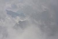 Ridges of mountains in the fog. High Tatras, Slovakia. June 2009. Mission: Ticha