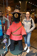 Gastown. Tourists taking souvenir with plush black bear Mounty.