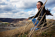 Maria Gunnoe sits on top of Kayford Mountain, West Virginia, overlooking a mine site on Wednesday, December 9, 2009. Gunnoe has been an activist against mountaintop removal coal mining for close to a decade and experiences a great deal of opposition from community members for her stance.