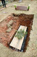 A casket made from beetle-killed pine trees is laid to rest in the Manitou Springs, Colorado cemetary after a funeral April 2, 2010. Colorado has 3 million acres of forest killed by mountain pine beetles and many uses are being found for the wood.  REUTERS/Rick Wilking (UNITED STATES)