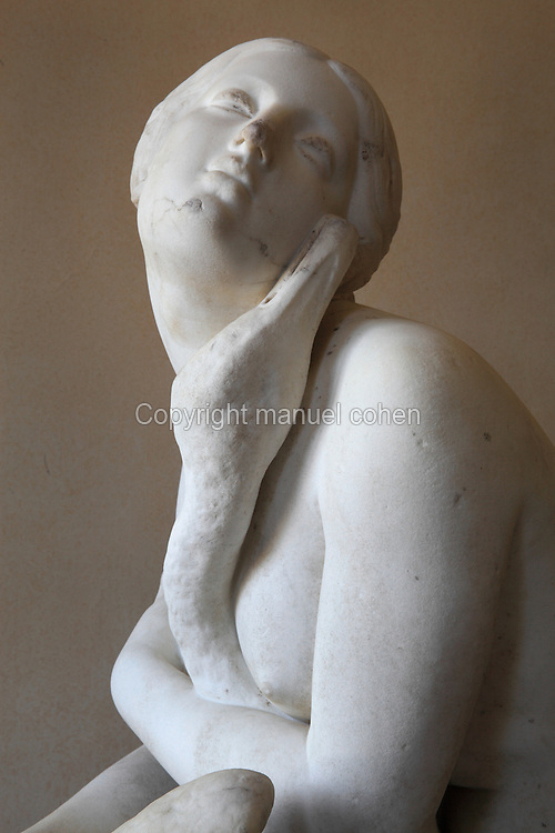 Detail of Leda from the sculpture of Leda and the Swan, by Antoine Etex, 1808-88, showing Leda being seduced by Zeus in the form of a swan, from the upper chateau, 18th century, at the Domaine de Villarceaux, Chaussy, France. The domaine is on the site of an 11th century medieval castle and comprises a water garden, manor house and 18th century chateau. It is managed by the Regional Council of the Ile de France, with the owners, Fondation Leopold Mayer. The garden is listed as one of the Notable Gardens of France, and the domaine is a Monument Historique. Picture by Manuel Cohen