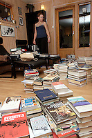 Woman with lots of books on the floor