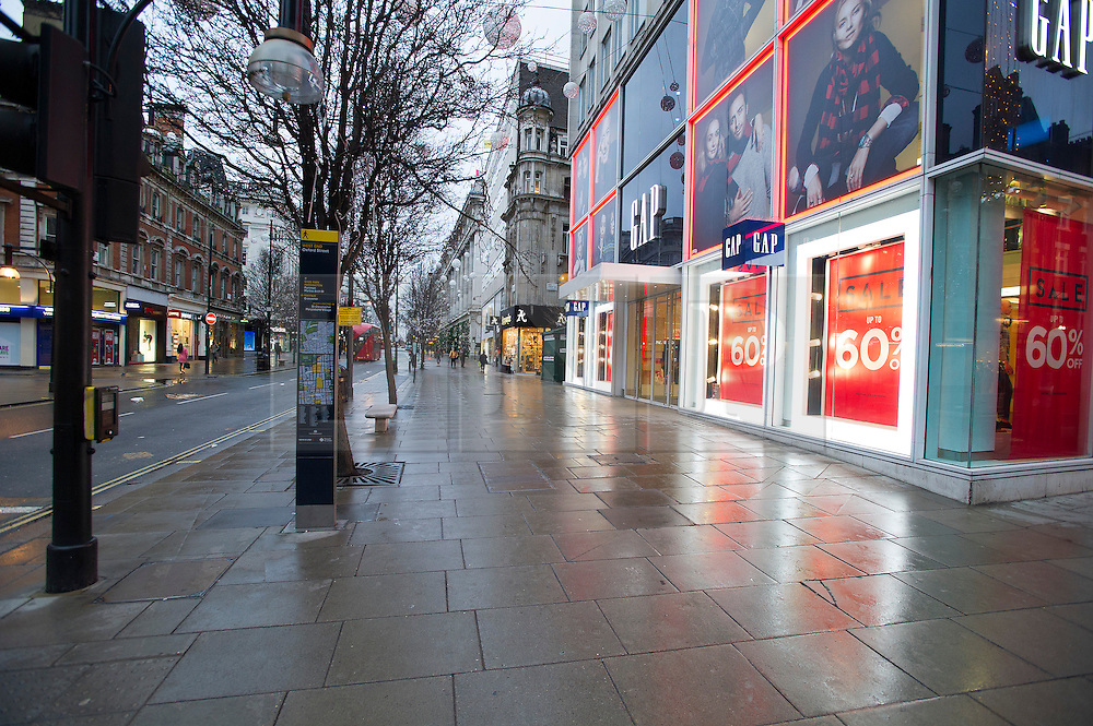 © London News Pictures. 21/12/2013 . London, UK.  An empty Oxford Street in London at 8.30am before shops on 21 December, the busiest shopping day of the year ahead of Christmas day next week. Photo credit : Ben Cawthra/LNP