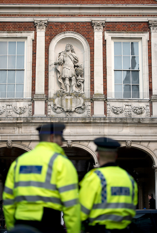 © London News Pictures. 28/03/2013 . Windsor, UK.  Police outside the Guild Hall in Windsor, Berkshire during the opening of an inquest into the death of russian oligarch Boris Berezovsky. Boris Berezovsky was found lying on a bathroom floor of his home in Ascot, Berkshire with a ligature around his neck.Photo credit : Ben Cawthra/LNP