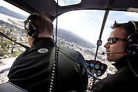 Todd Stam looks over the downtown Coeur d'Alene area as he flies over the city Monday, May 9, 2011 during a sight seeing tour and inspection of flood damage on Hayden Lake.