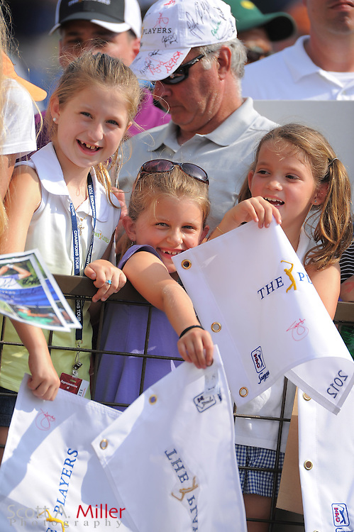 Fans seeking autographs during the third round of the Players Championship at the TPC Sawgrass on May 12, 2012 in Ponte Vedra, Fla. ..©2012 Scott A. Miller..