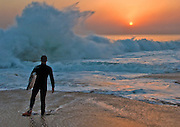 Male Boogie Boarder Standing on the Beach at Sunset