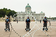24 NOVEMBER 2012 - BANGKOK, THAILAND:  Thai police guard the Royal Plaze in Bangkok during a large anti government, pro-monarchy, protest  on November 24, 2012 in Bangkok, Thailand. The Siam Pitak group, which sponsored the protest, cited alleged government corruption and anti-monarchist elements within the ruling party as grounds for the protest. Police used tear gas and baton charges againt protesters.       PHOTO BY JACK KURTZ