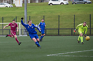 Sean Kelly fires Dundee Saturday Morning Football League side St James (blue) into the lead (1-0) during their North of Tay Cup tie against Arbroath HSFP (maroon) at DISC, Dundee<br /> <br /> <br />  - &copy; David Young - www.davidyoungphoto.co.uk - email: davidyoungphoto@gmail.com