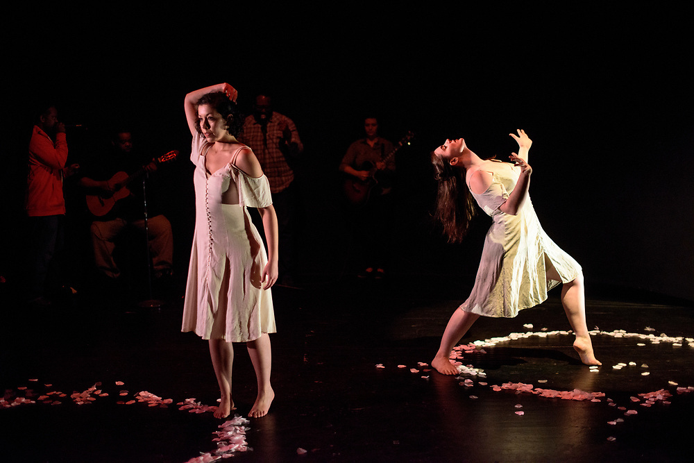 Baltimore, Maryland - April 25, 2017: The Threshold (Polly Mizani, choreographer)<br /> <br /> An intimate look at the often-concealed pain and struggle that come along with love and commitment through a self-reflective duet. <br /> The piece has a live band and white flower petals.  <br /> <br /> Baltimore modern dance company The Collective's annual concert &quot;This is Home&quot; at the Baltimore Theatre Project. <br /> <br /> <br /> CREDIT: Matt Roth