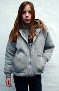 Girl wearing a grey hoodie